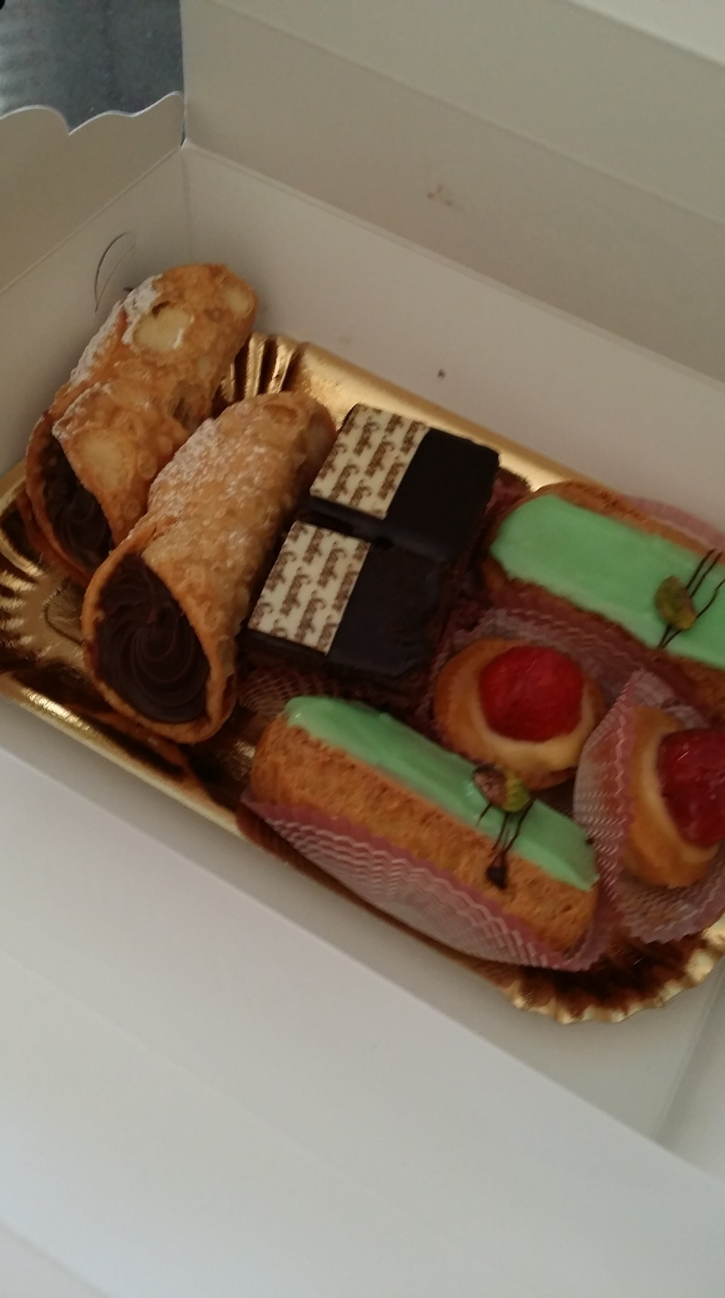 Pisachio eclairs, chocolate custard cannoli,strawberry tartlets and sacher torte