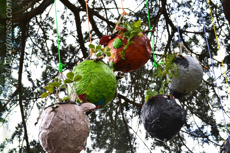 Children made papier mache flower hangers for the trees in the park