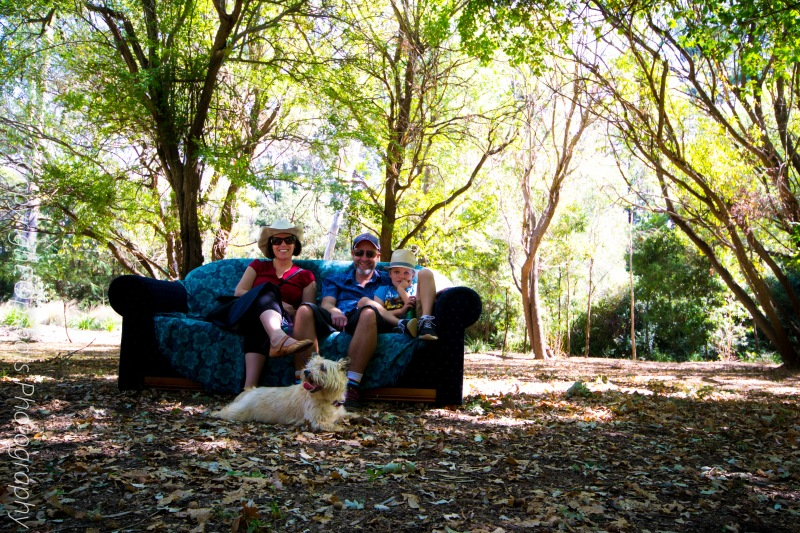 This young family and their Cairn Terrier Mary relaxing on one of the many couches set up in the park