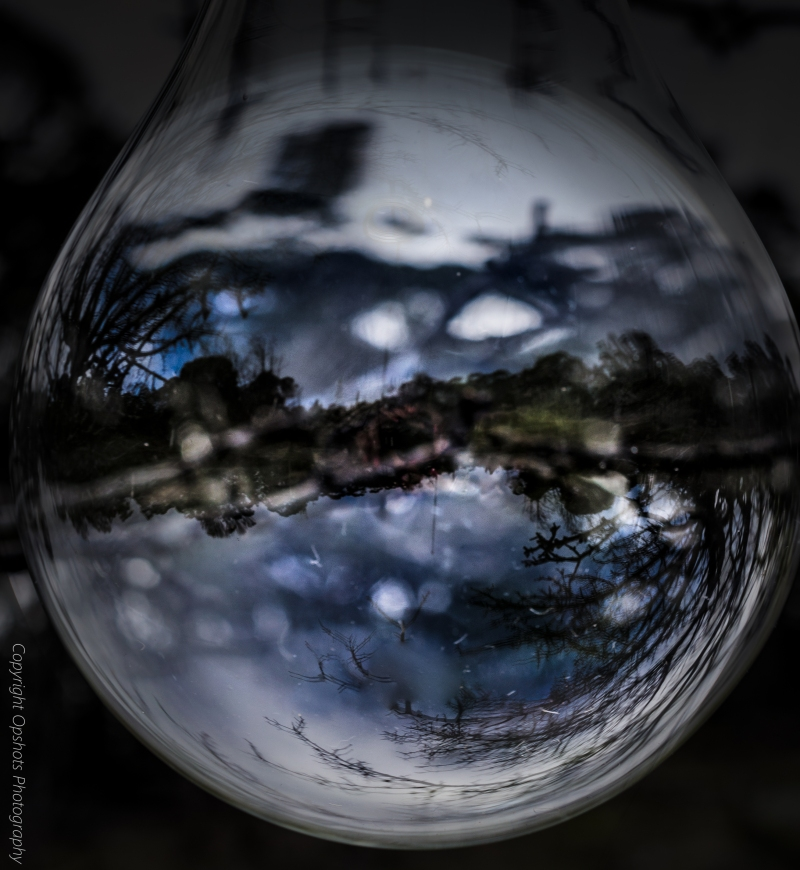 A compilation image of one i took @ Mount Alexander..a novelty over sized light bulb against the backdrop of mountains..i flipped one image and created a sphere..the image of mountains and clouds within is my take on a global perspective of nature